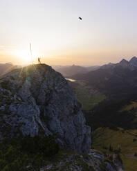 Hiker on viewpoint during sunset, Gaichtspitze, Tyrol, Austria - MALF00074