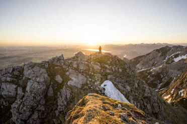 Hiker on viewpoint during sunset, Aggenstein, Bavaria, Germany - MALF00083