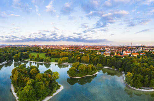 Germany, Bavaria, Munich, Drone view of Kleinhesseloher See and Electors Island in English Garden at dawn - SIEF09997