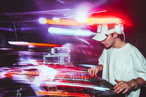 Portrait of confident young DJ with headphones - CAVF88356