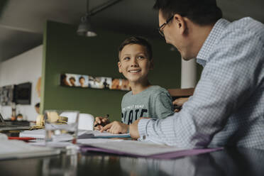 Father helping son with his homework - MFF06037