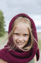 Portrait of smiling blond girl with round scarf - EYAF01266