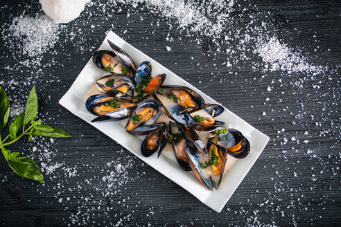 Steamed mussels with Thai sauce in white plate - ADSF12540