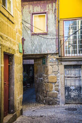 Portugal, Porto District, Porto, Cobblestone alley between old houses - NGF00647