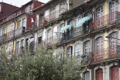 Portugal,Porto District, Porto, Balconies of colorful townhouses - NGF00656