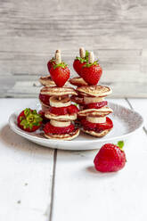 Plate of mini pancakes with strawberries and bananas - SARF04617