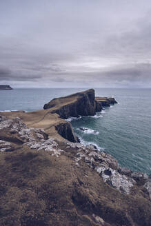 UK, Scotland, Cloudy sky over Neist Point peninsula - RSGF00259