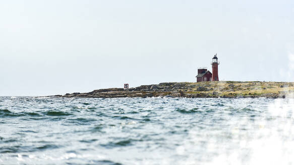 Mid distant view of lighthouse on Halmstad Island against clear sky - JEDF00334