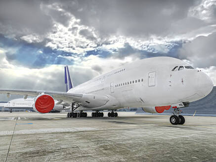 Airbus parked on runway at airport against cloudy sky - WEF00469