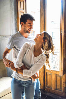 Young beautiful couple dancing and smiling in daylight. - EHF00956