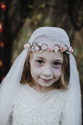 Cute girl wearing costume of corpse bride while standing in forest - GMLF00543