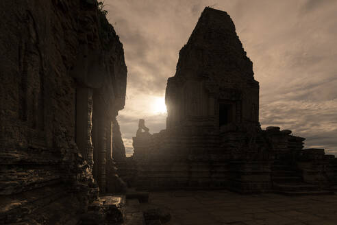 Spectacular scenery of traditional Buddhist temple with monuments of animals on background of magnificent sundown in Cambodia - ADSF15391