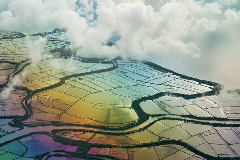Spectacular drone view of agricultural rice paddies with water reflecting colorful sky and clouds - ADSF15635