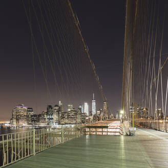 USA, New York, New York City, Brooklyn Bridge at night - AHF00014