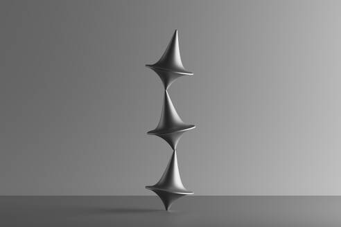 Three metallic spinning whirligigs balancing on top of each other, 3D Render - DRBF00205