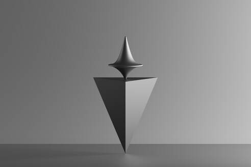 Metallic spinning whirligig balancing on top of a pyramid, 3D Render - DRBF00208