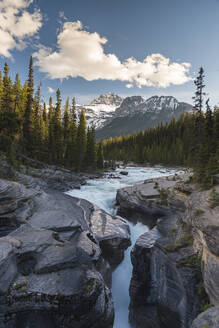 Mistaya Canyon waterfalls at sunset with evening light and Mount Sarbach, Banff National Park, UNESCO World Heritage Site, Alberta, Canadian Rockies, Canada, North America - RHPLF17744