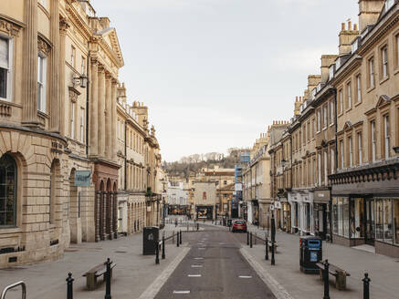 Buildings along empty main street, Bath, Somerset, UK - FSIF05252