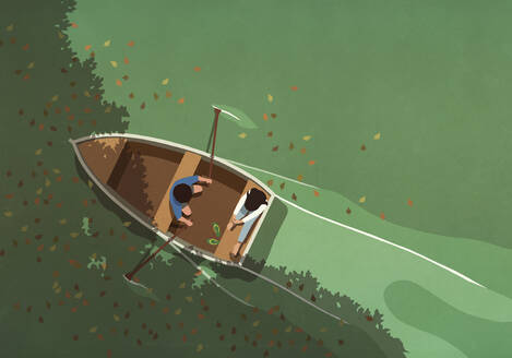 Autumn leaves falling around couple in rowboat on lake - FSIF05258