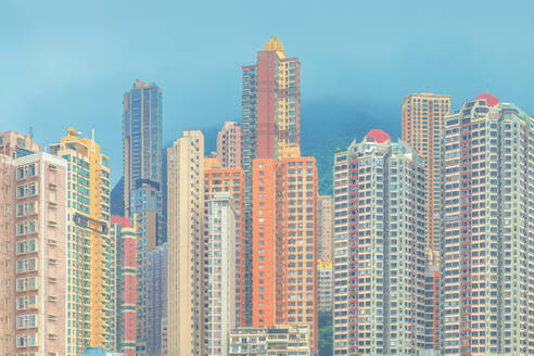 Modern buildings against blue sky in city, Hong Kong - LCUF00127