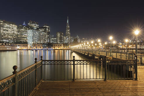 Pier 7 with illuminated building in background at San Francisco, California, USA - AHF00117