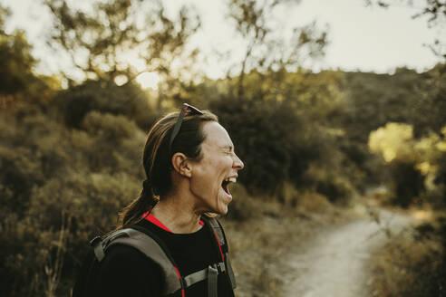 Woman screaming while standing at Sierra De Hornachuelos, Cordoba, Spain - DMGF00152