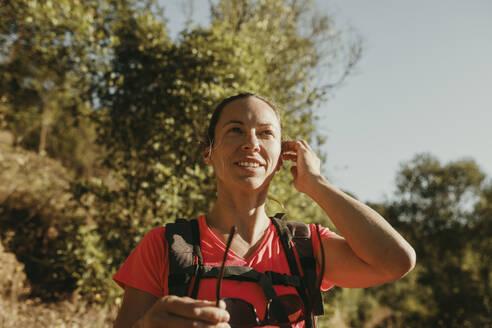Smiling woman exploring Sierra De Hornachuelos, Cordoba, Spain - DMGF00164
