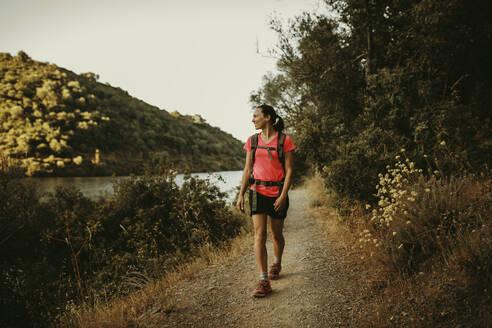 Trekker walking on footpath at Sierra De Hornachuelos, Cordoba, Spain - DMGF00167