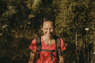 Woman with eyes closed standing at Sierra De Hornachuelos, Cordoba, Spain - DMGF00170