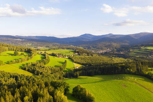 Drone view of Lamer Winkel valley in summer with Kleiner Arber and Grosser Arber mountains in distant background - SIEF10061