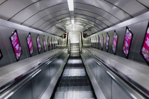 UK, England, London, Empty escalator in railroad station - MRRF00574