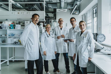 Confident scientist team standing together at laboratory - MFF06549