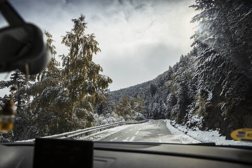 View from car driving along alpine highway in winter - ACPF00830