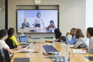 Business people video conferencing in conference room - CAIF29718