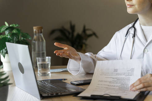 Young female doctor discussing on video call during online consultation - AFVF07381