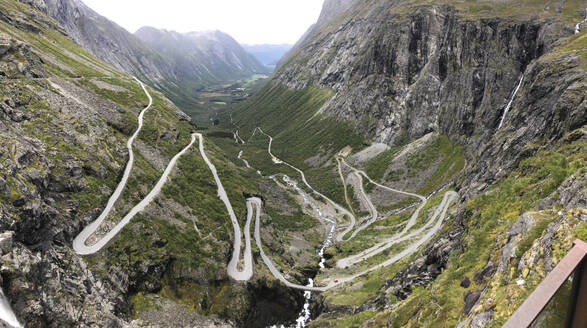 A windy road in a valley in Trollstigen, Norway - CAVF90196
