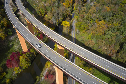 USA, West Virginia, Aerial view of U.S. Route 48 bridge stretching over Lost River in Appalachian Mountains - BCDF00465