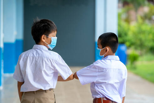 Elementary school students with face mask back at school after c - CAVF90510