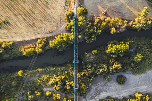 Bridge crossing river in landscape, aerial view - RSGF00451