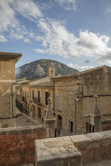 Spain, Mallorca, Pollenca, Old town houses with mountain in background - JMF00544