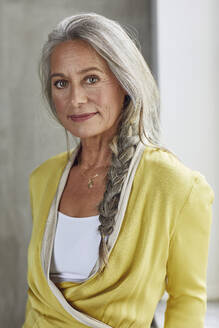 Confident businesswoman with gray hair at home office - MCF01561