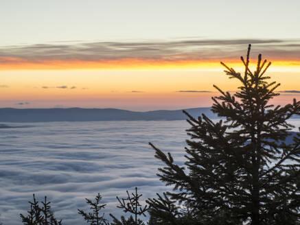 Sun setting over foggy landscape seen from summit ofHeugstattmountain - HUSF00151