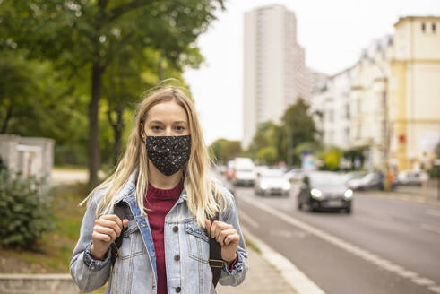 Woman with protective face mask in city during COVID-19 - BFRF02350