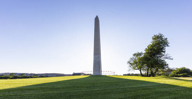 USA, Washington DC, Washington Monument casting long shadow on surrounding lawn - AHF00215