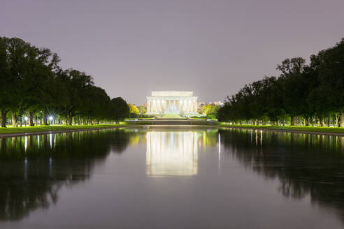 USA, Washington DC, Lincoln Memorial reflecting in Lincoln Memorial Reflecting Pool at night - AHF00221