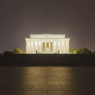 USA, Washington DC, Pavement in front of illuminated Lincoln Memorial at night - AHF00227