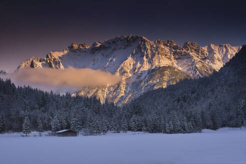 Scenic view of snowy forest against mountains during sunset - MRF02407