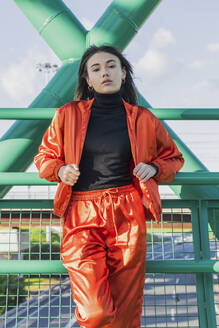 Confident young woman standing on bridge - JRVF00011