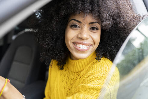 Happy woman smiling while driving car - JCCMF00396