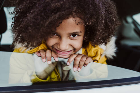 cute afro girl in a car outdoors, Madrid, Spain - EBBF01987
